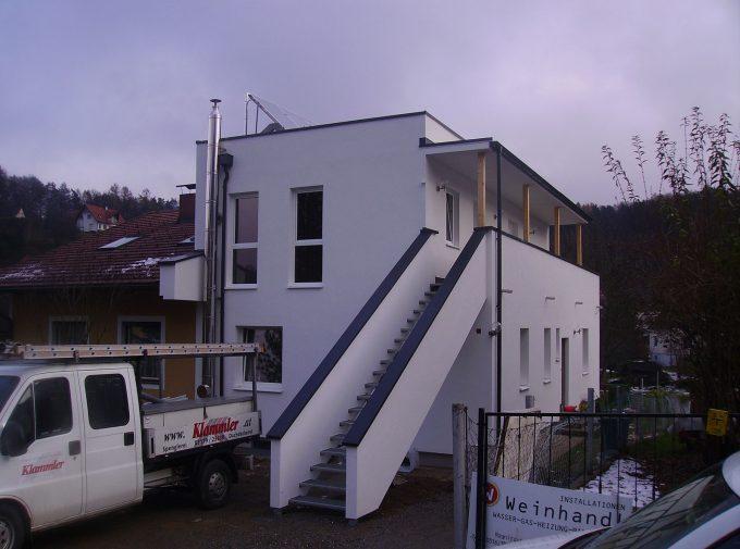 Mehrfamilienhaus gedeckt von Klammler